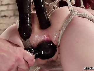 Ball-gagged bound redhead rails ticklish pony