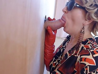 Mummy in footwear sees porno and likes gloryhole suck off