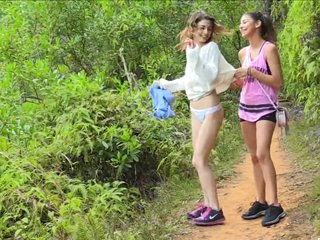 younger women getting naked in nature