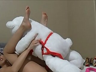 Teenage woman pounds teddybear