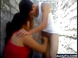 Indian duo oral pleasure outdoors